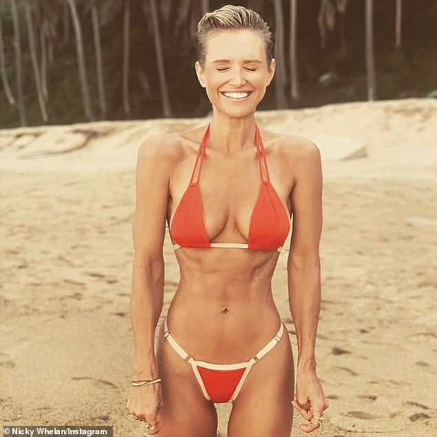 Nicky Whelan shows off her trim physique in an orange bikinias she holidays in Mexico 1
