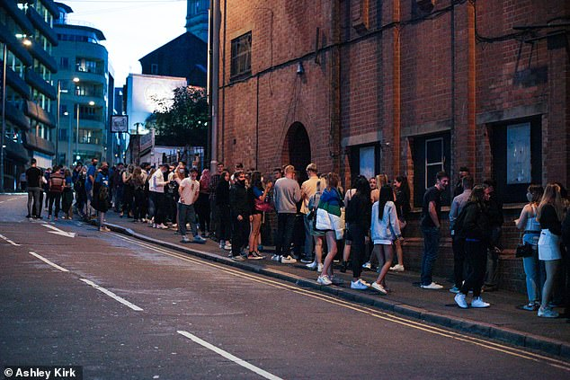 Freshers ignore social distancing as they cram on pavement outside club 3