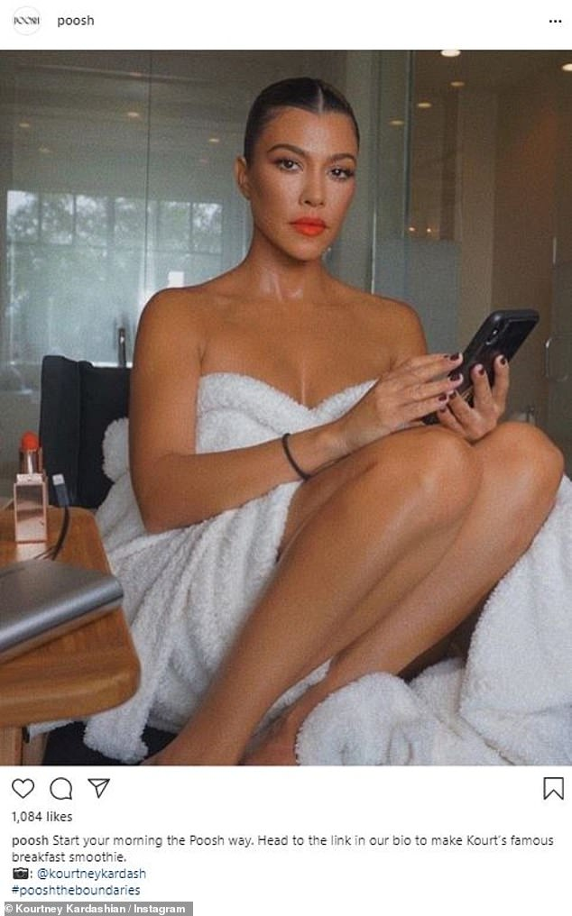 Kourtney Kardashian highlights her flawless skin and trim figure in a bathrobe as she starts her day 2