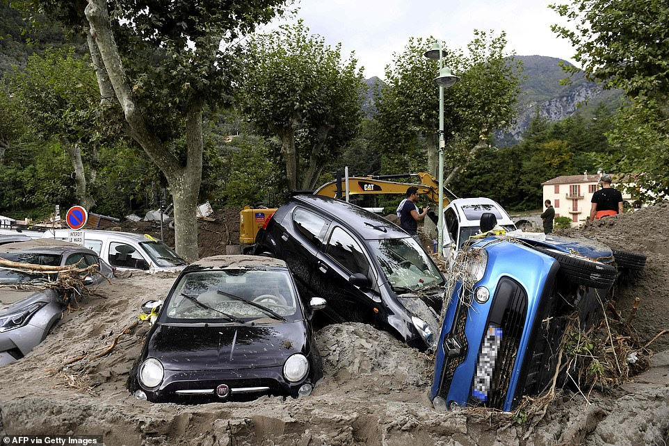 Army is deployed in France and rescue teams hunt for survivors in Italy after torrential rai 1