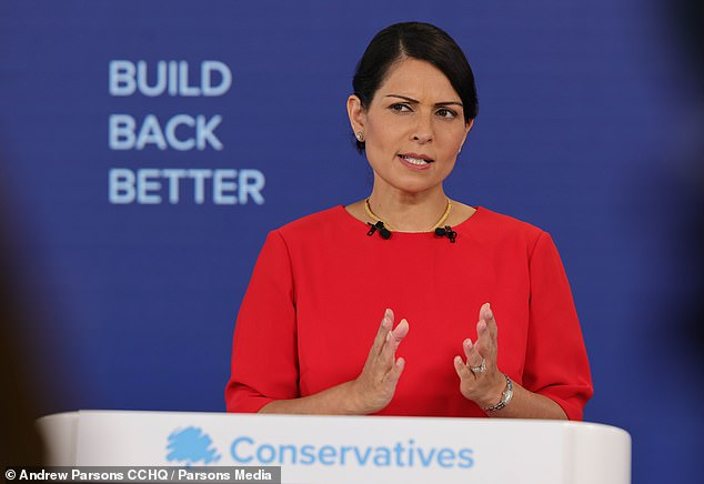 HENRY DEEDES watches Priti Patel addressing the Conservative Party conference 5