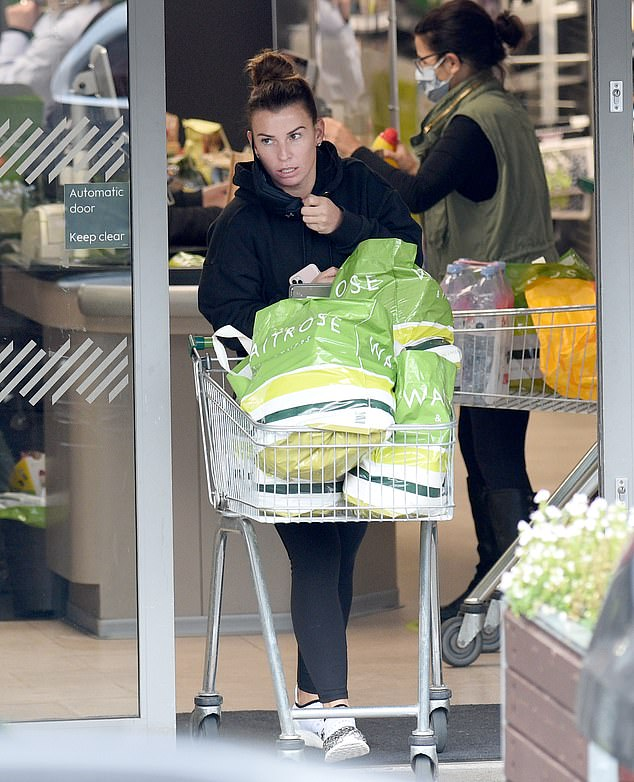 Coleen Rooney cuts a pensive figure as she goes food shopping in Cheshire 6