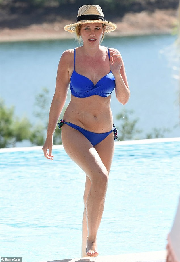 Amy Hart displays her toned figure in a blue bikini as she enjoys a relaxing pool day in Portugal 1