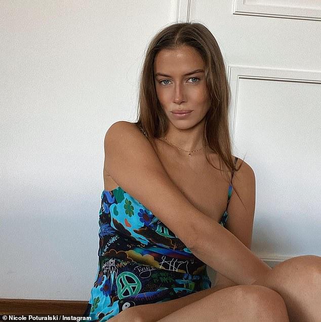 Brad Pitt's model girlfriend Nicole Poturalski, 27, strikes a pose in a blue printed mini dress 6