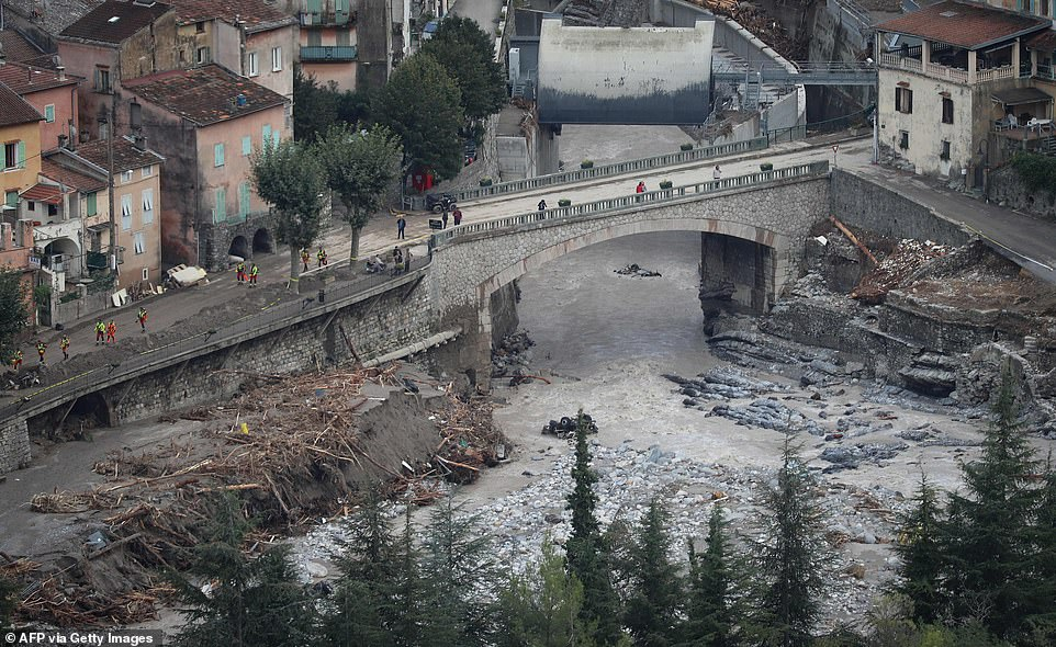 Death toll in flooding across France and Italy rises to 12 as six bodies wash up on a shoreline 6