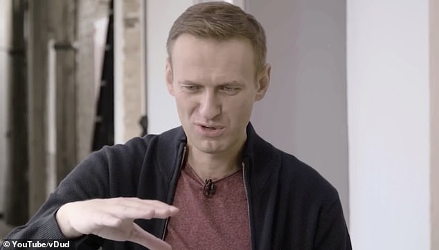Alexei Navalny shows off his shaking hand as he reveals the effects of his novichok poisoning 4