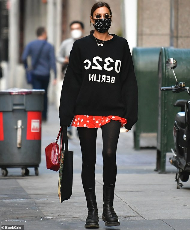 Irina Shayk covers up in a sweater with polka dot shorts 5