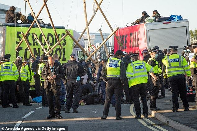 Scientist is fined £105 for taking part in eco protests at printing site that cost publishers £1.2m 4