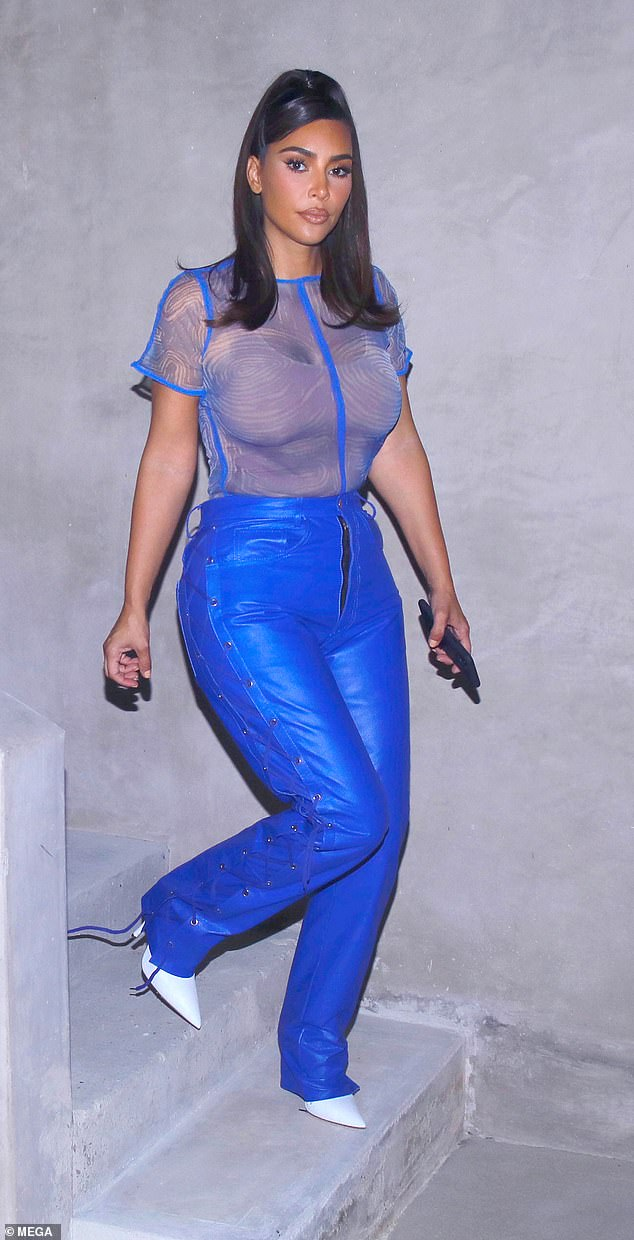 Kim Kardashian goes bold in blue sheer top and leather pants as she leaves friends house in LA 2
