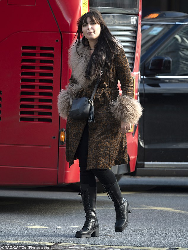 Daisy Lowe cuts a chic figure in fur-adorned leopard print coat and lace-up boots 3