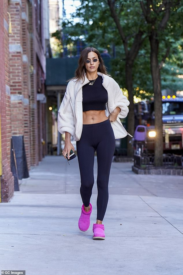 Irina Shayk puts her incredible abs on display in a crop top and black leggings in New York 5