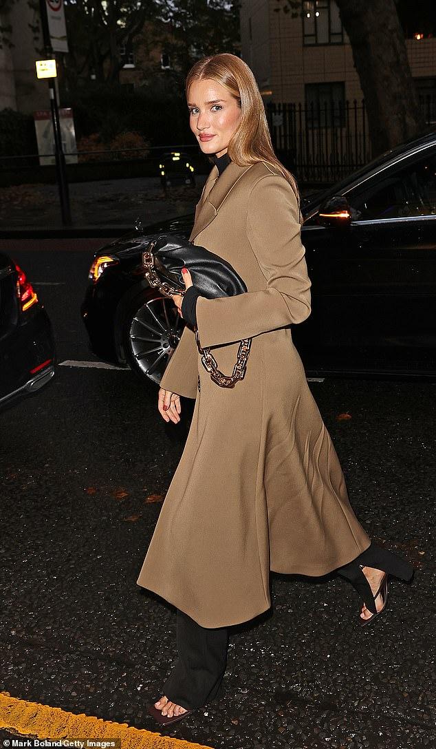 Rosie Huntington-Whiteley looks chic in long camel coat and as she heads to Bottega Veneta event 5