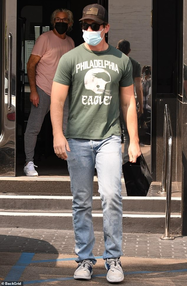Miles Teller reps the Philadelphia Eagles in a green T-shirt as he goes jewelry shopping 6