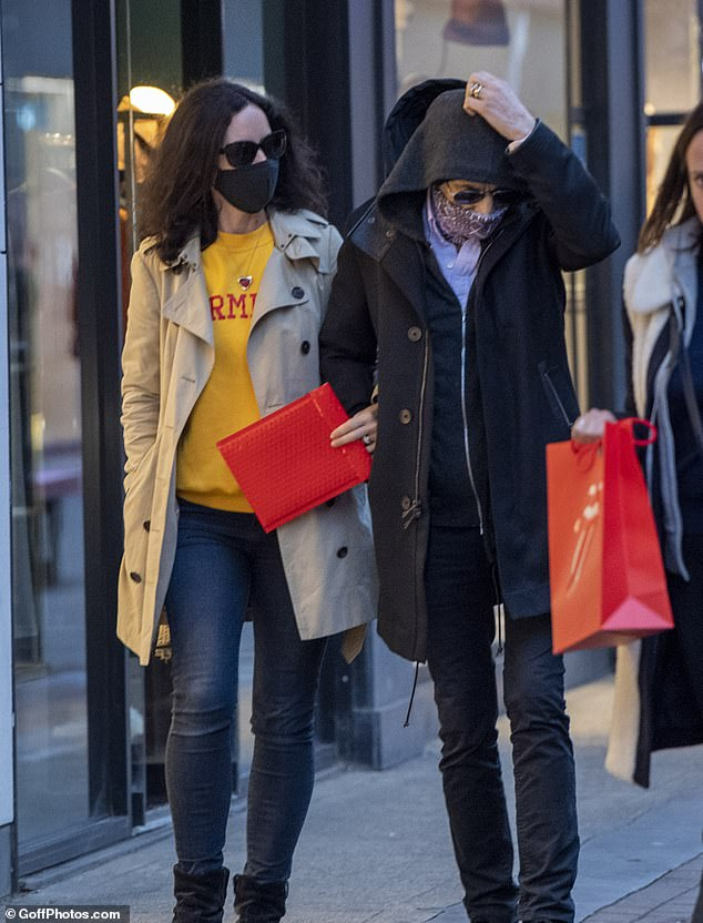 Ronnie Wood, 73, and wife, Sally, 42, visit the Rolling Stones store 5
