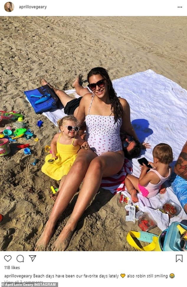 Pregnant April Love Geary enjoys beach day withfiance Robin Thicke and their two young daughters 5