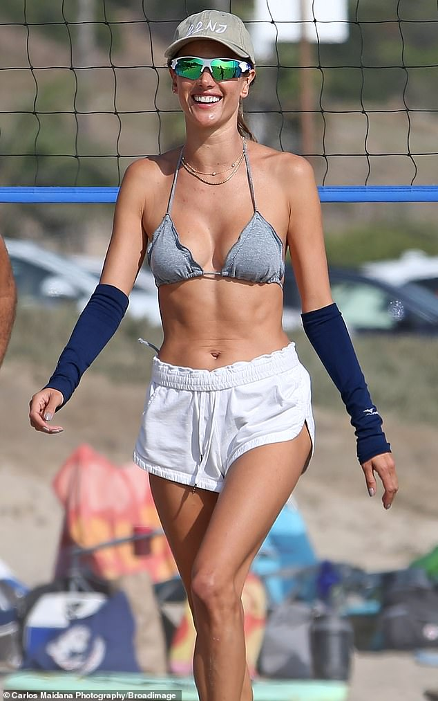 Alessandra Ambrosio puts her toned bod on display in bikini top and shorts on beach in Santa Monica 1