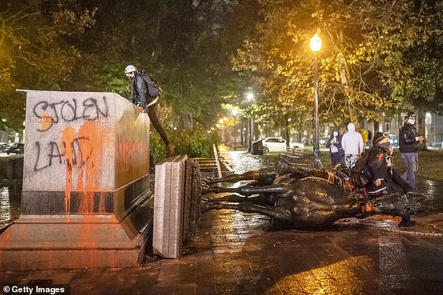 Statues of Abraham Lincoln and Theodore Roosevelt toppled in Portland 1
