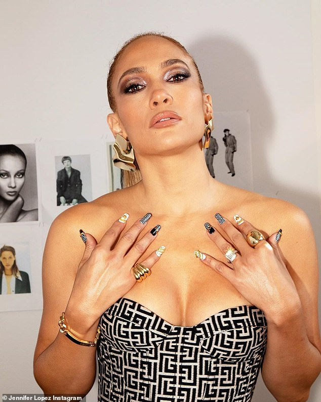 Jennifer Lopez, 51, flaunts her cleavage in a low-cut dress from the Balmain show 2