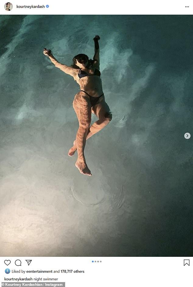 Kourtney Kardashian shows off her pert derriere in a racy thong bikini on a night swim 4