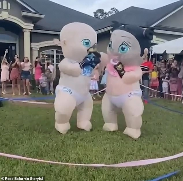 Inflatable babies slug it out in 'boxing match' as couple take gender reveal parties to a new level  8