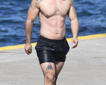 Celebrity personal trainer Jono Castano shows off his six-pack at the beach 5