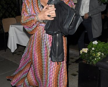 EastEnders star Jessie Wallace nearly spills out of her multicoloured wrap dress after a night out 4