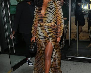 Gabrielle Union turns heads in a plunging tiger print dress as she steps out for dinner at Catch 2