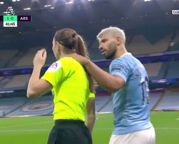 Moment Manchester City striker Sergio Aguero grabs assistant referee Sian Massey-Ellis around neck 6