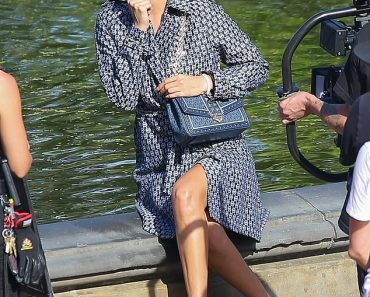 Bella Hadid shows off sculpted legs in 1950s chic wrap coat during Central Park fashion shoot 2