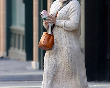Hilary Duff looks cozy in a cable knit sweater dress as she steps out in New York City 1