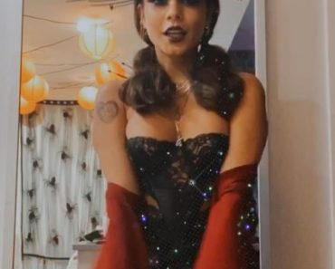 Vanessa Hudgens dons a vampish lace basque and elaborate headdress as she counts down to Halloween 3