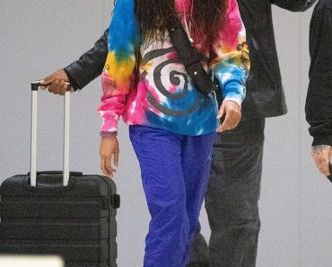 Willow Smith is seen in a tie-dye top with very long hair as she lands in NYC 6
