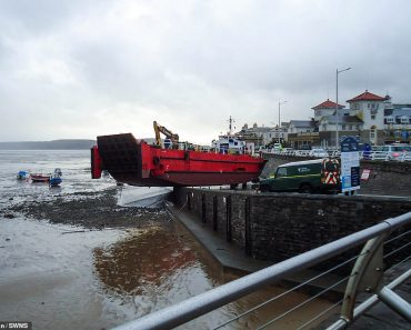 Ship teeters on the edge of Somerset slipway after being caught out by tide 1