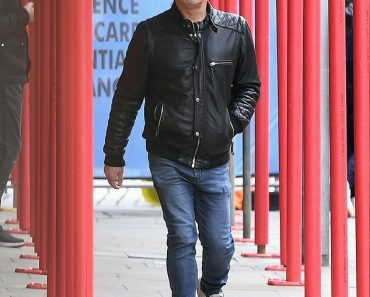 Sid Owen cuts a sombre figure as he steps out after losing six teeth and shattering his jaw 5