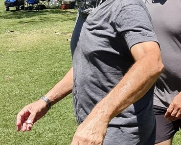 Tom Hanks looks fit as he goes for a power walk in Queensland 5