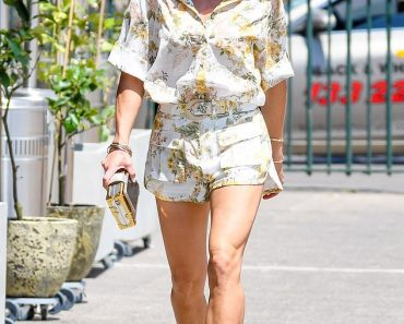 Candice Warner struts her stuff in a $10,000 designer outfit 2
