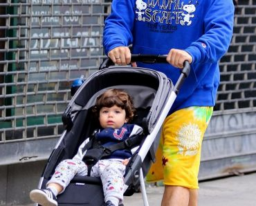 Andy Cohen wears Snoopy-themed hoodie as he pushes 20-month-old son Benjamin in stroller in NYC 2