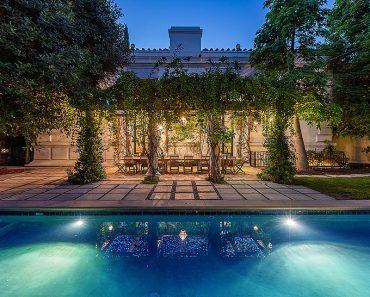 Bridget Fonda and husband Danny Elfman list neighboring LA mansions for a combined $14.6million 2