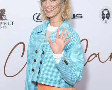 Delta Goodrem stands out in a blue cropped Fendi jacket and orange dress at Melbourne Cup launch 6